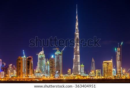 Night view of Dubai Downtown with Burj Khalifa - stock photo