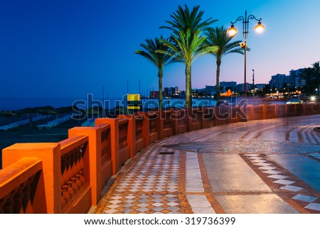 Night View Of Embankment In Benalmadena. Benalmadena is a town in Andalusia in Spain, 12 km west of Malaga, on the Costa del Sol. It caters for a large number of tourists. - stock photo