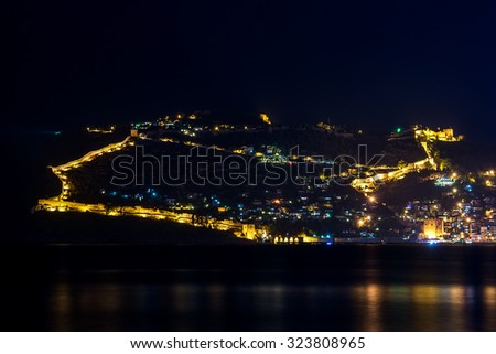 Night view of harbor and fortress of Alanya, Turkey. - stock photo