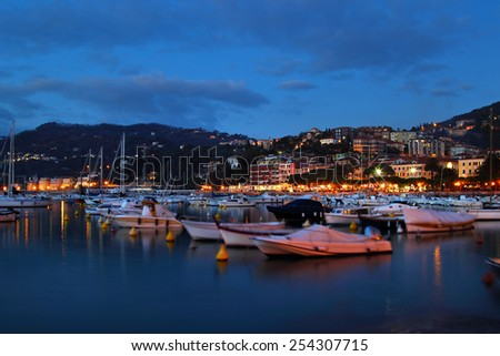 Night view of harbor with yachts in Lerici, Italy