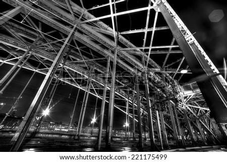 Night view of Hohenzollern Bridge in Cologne, Germany.Night photo. B&W. - stock photo