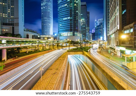 night view of Hong Kong with traffic trails - stock photo