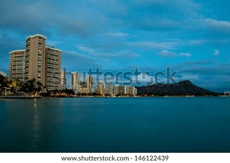 Night view of Honolulu city, Diamond Head and Waikiki Beach; Hawaii, USA - stock photo