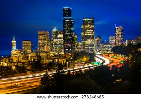 Night view of I-5 and the Seattle skyline from the Jose Rizal Bridge, in Seattle, Washington.