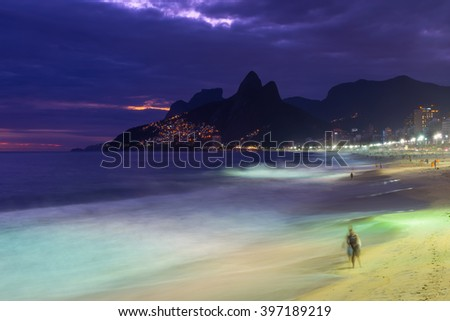 Night view of Ipanema beach and mountain Dois Irmao (Two Brother) in Rio de Janeiro, Brazil - stock photo