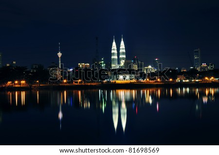 Night view of Kuala Lumpur city with reflection in water - stock photo