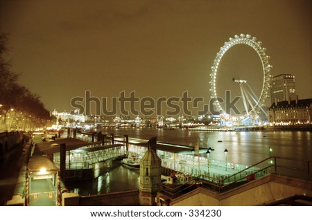 night view of London Eye on Thames River - stock photo