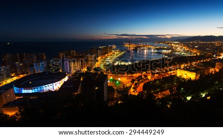 Night view of  Malaga with Port and Placa de Torros from castle - stock photo