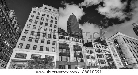 Night view of Manhattan Buildings from the street. New York City. - stock photo