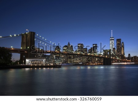 Night view of Manhattan in New York City. Freedom Tower is visible on the right. - stock photo