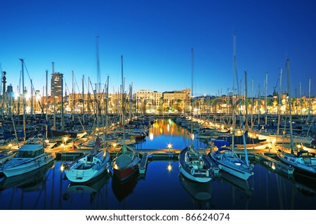 Night view of Marina Port Vell in Barcelona - Spain (long exposure) - stock photo