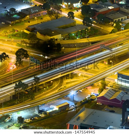 night view of melbourne city streets showing freeway flyover and buildings  - stock photo