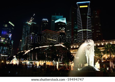 Night view of Merlion statue and skyscrapers in Singapore city - stock photo