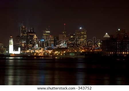 Night view of mid-town of Montreal reflecting in St Lawrence river,Quebec, Canada - stock photo
