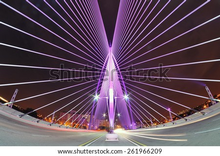 Night view of modern bridge architecture at Putrajaya, Malaysia in different colors. - stock photo