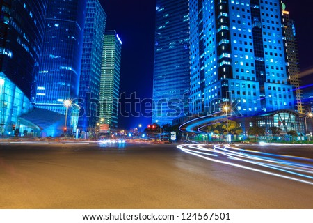 night view of modern street in shanghai financial district - stock photo