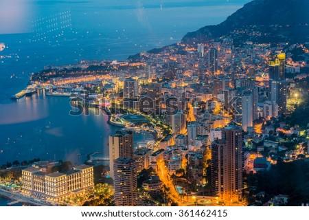 Night view of Monaco from mountain - stock photo