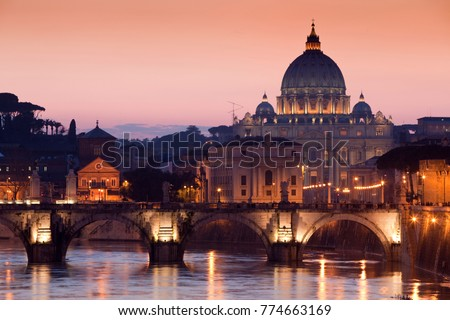 Night view of old Sant' Angelo Bridge and St. Peter's cathedral in Vatican City Rome Italy.