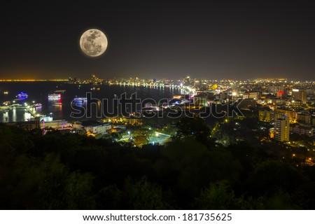 Night view of Pattaya bay with full moon, Thailand. - stock photo