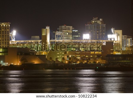 Night view of Petco Park in San Diego, California. This is the home field of the San Diego Padres baseball team. The view is from Coronado Island. - stock photo