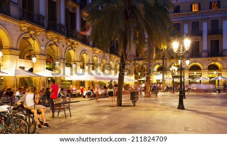 night view of Placa Reial with restaurants in summer. Barcelona, Spain - stock photo
