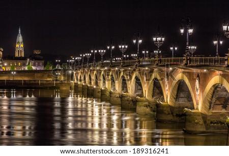Night view of Pont de pierre in Bordeaux - Aquitaine, France - stock photo