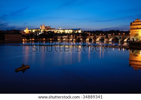 Night view of Prague castle and reflection on vltava river