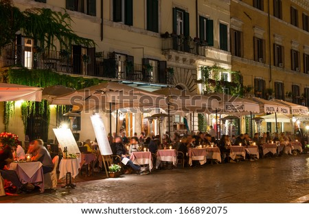 Night view of restaurants on Piazza Navona in Rome, Italy - stock photo