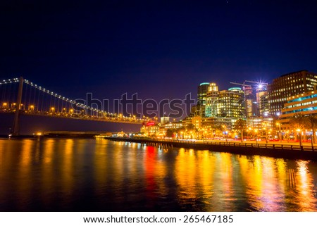Night view of San Francisco and the Bay Bridge.  Cityscape from Pier 14. Night sky. - stock photo