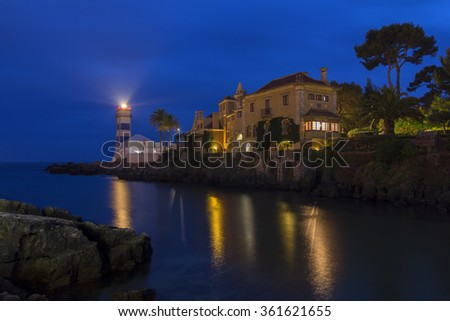 Night view of Santa Marta lighthouse and village museum in Cascais, Portugal