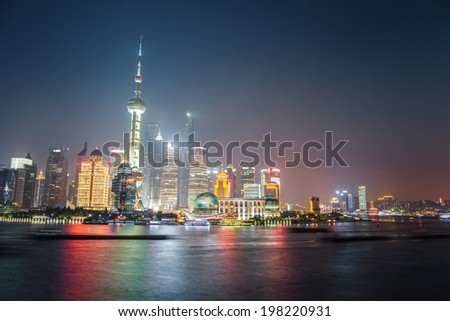 night view of shanghai skyline with huangpu river  ,beautiful modern city background