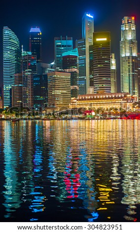 Night view of Singapore Downtown Core with reflection in the river - stock photo