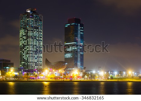 night view of skyscrapers fron sea - center of nightlife at Barcelona. Catalonia, Spain  - stock photo