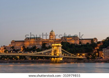 Night view of some of the most famous Hungarian landmarks, including the Szechenyi Chain Bridge and the Royal Palace as seen from the other side of the Danube river. Long Exposure. - stock photo