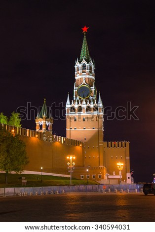 Night view of Spasskaya Tower of the Moscow Kremlin and wall of the Kremlin with illumination and streetlights - stock photo