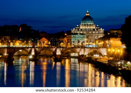 Night view of St. Peter's Basilica and Angels Bridge - stock photo