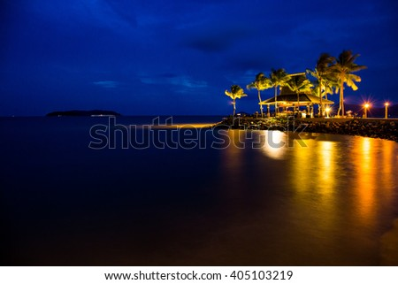 Night view of sunset bar with blue sky at tropical beach. Taking pictures with long exposure. - stock photo