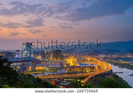 night view of taipei in nangang with traffic trails - stock photo