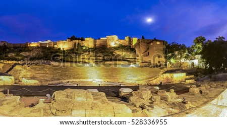 Night view of the Alcazaba fortress and the Roman theatre in Malaga, Spain