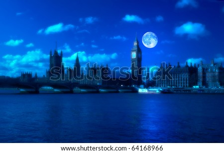 Night view of the Big Ben and the Houses of Parliament with a full moon - stock photo
