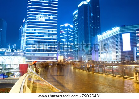night view of the bustling city on the pedestrian bridge in shanghai,China - stock photo