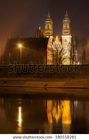 Night view of the Cathedral over the river Warta Poznan