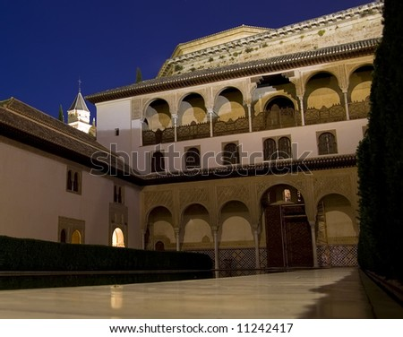 Night view of the Court of the Myrtles in the Nasrid Palaces in the Alhambra, Granada, Spain. - stock photo
