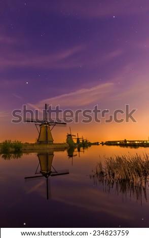 Night view of the dutch windmills at Kinderdijk, an UNESCO world heritage site. - stock photo