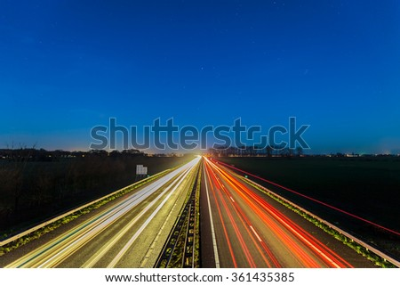 Night view of the highway between the Dutch cities of Arnhem and Doesburg - stock photo