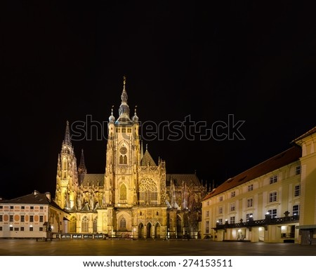 night view of the illuminated saint vitus cathedral situated in the middle of prague castle. - stock photo