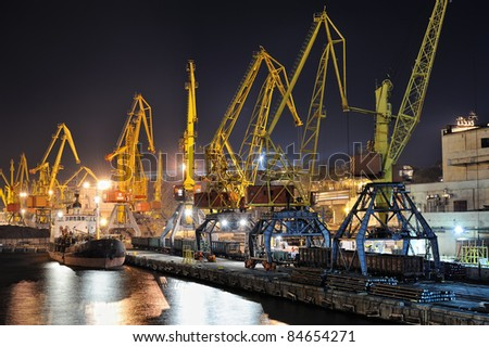 night view of the industrial port with cargoes and ship - stock photo