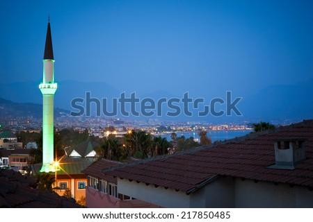 Night view of The Kuyularonu Mosque and cityscape of Alanya. Bostancipinari Cd., Alanya, Antalya Province, Turkey - stock photo