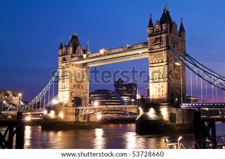 Night view of the London Bridge and the river Thames - stock photo