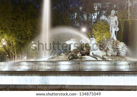 night view of the Neptuno Fountain, Canovas del Castillo square, Madrid - stock photo